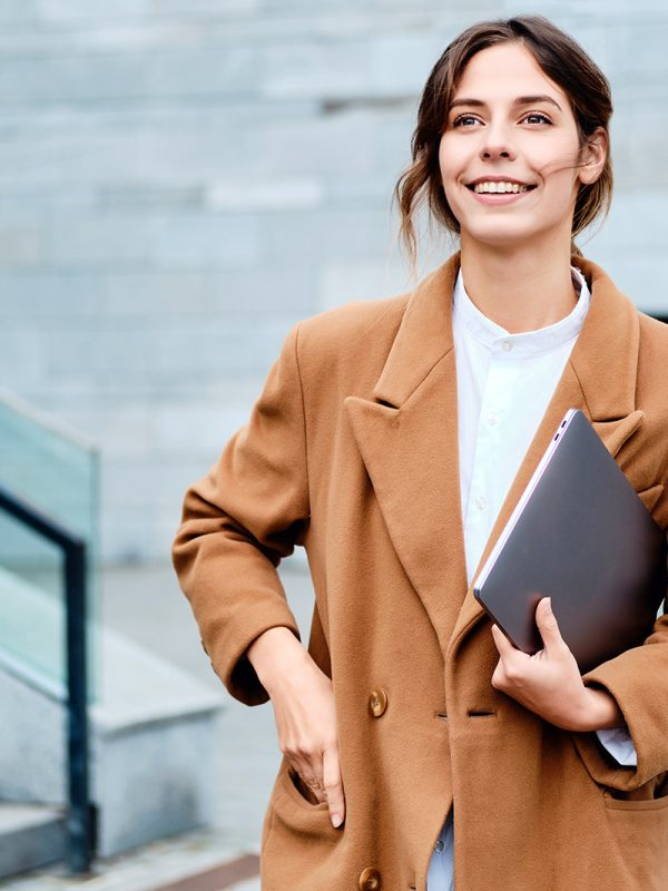 young-pretty-smiling-businesswoman-in-coat-with-2J3SG5G.jpg